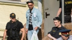 Russia's theater and film director Kirill Serebrennikov, centre, is escorted after a hearing in a court in Moscow, Russia, Wednesday, Aug. 23, 2017. (AP Photo/Alexander Zemlianichenko)