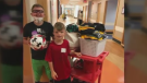 Peyton West is pictured here with his younger brother Nolan in the hospital. (WKRC-TV)