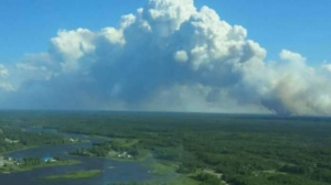 The decision to carry out a full evacuation was made on Tuesday by the first nation's leadership, due to smoke and the proximity of the fire, according to a spokesperson for the Canadian Red Cross, which is assisting with the evacuation. (Source: April Swain)