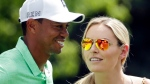 In this April 8, 2015, file photo, Lindsey Vonn speaks to Tiger Woods during the Par 3 contest at the Masters golf tournament in Augusta, Ga. (AP Photo/Charlie Riedel, File)