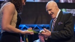 FILE- In this Feb. 15, 2017, file photo, retired professional wrestler Bruno Sammartino examines U.S. rower Amanda Polk's Olympic gold medal at the 81st Dapper Dan Awards and sports auction, a fundraiser for the Boys & Girls Clubs of Western Pennsylvania, in Pittsburgh. (Haley Nelson/Pittsburgh Post-Gazette via AP, File)