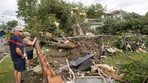 Residents survey the damage from a category one tornado, Wednesday, Aug. 23, 2017 in Lachute, Que., northwest of Montreal. (Ryan Remiorz / THE CANADIAN PRESS)