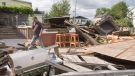 Michel Laurin surveys the damage to his backyard from a category one tornado, Wednesday, Aug. 23, 2017 in Lachute, Que. northwest of Montreal. (Ryan Remiorz / THE CANADIAN PRESS)