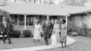 In this May 3, 1982 file photo, President Ronald Reagan and first lady Nancy Reagan walk with Barbara and Phillip Butler and their daughter Natasha, outside the family's home in College Park, Md., May 3, 1982. (AP Photo / Barry Thumma, File)