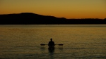 A kayaker stops to take in the sunset over Patricia Bay, Aug. 21, 2017. (Photo courtesy Frank Towler)