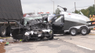 A black truck and a transport collided on Truck Road on Wednesday afternoon. (LincolnLouttit/CTVNorthernOntario)