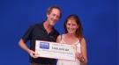 John Krikken and Melissa Sasseville show off their winnings.