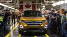 Ford Motor Company President of the Americas Joe Hinrichs drives the first car to the end of the production line, as Ford Motor Company celebrates the global production start of the 2015 Ford Edge at the Ford Assembly Plant in Oakville, Ont., on Thursday, February 26, 2015. (THE CANADIAN PRESS/Chris Young)