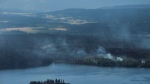 Wildfires are seen from a Canadian Forces Chinook helicopter as Prime Minister Justin Trudeau views areas affected by wildfire near Williams Lake, B.C., on Monday, July 31, 2017. (THE CANADIAN PRESS / Darryl Dyck)