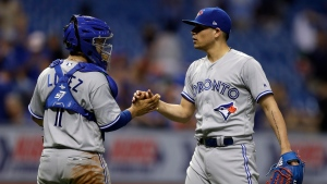 Toronto Blue Jays relief pitcher Roberto Osuna, right, shakes hands with catcher Raffy Lopez after the team's 7-6 win against the Tampa Bay Rays in a baseball game Wednesday, Aug. 23, 2017, in St. Petersburg, Fla. (AP Photo/Chris O'Meara)