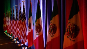 The flags of Canada, the U.S. and Mexico are lit by stage lights before a news conference at the start of NAFTA renegotiations in Washington, D.C., on Aug. 16, 2017. If Donald Trump deploys the big bomb during upcoming NAFTAnegotiations, and threatens to blow up the continental trade agreement, a unit within the office of Prime Minister Justin Trudeau will be assigned to try disarming it.THE CANADIAN PRESS/AP, Jacquelyn Martin