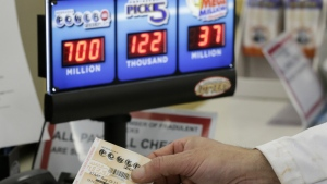 In this file photo, a customer is handed a Powerball ticket in Omaha, Neb. on Wednesday, Aug. 23, 2017. (AP / Nati Harnik)