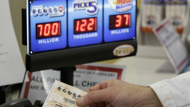 A customer is handed a Powerball ticket in Omaha, Neb. on Wednesday, Aug. 23, 2017. (AP / Nati Harnik)