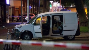 A van is examined behind a cordoned-off area in Rotterdam after a concert by an American rock band was cancelled Wednesday night following a threat, the city's mayor said, on Wednesday Aug. 23, 2017. (RTL)