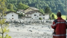 A landslide that hit the village Bondo in southern Switzerland is seen on Wednesday, Aug. 23, 2017. (Giancarlo Cattaneo / Keystone)