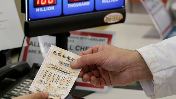 $315 million Powerball jackpot winner claims his prize