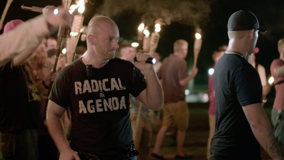 In this Friday, Aug. 11, 2017, image, Christopher Cantwell attends a white nationalist rally in Charlottesville, Va. (Vice News Tonight)