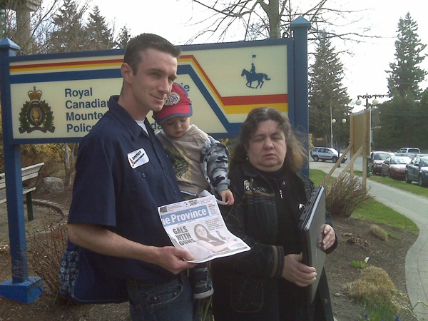 The family of Heather Storey speak to reporters outside of the Surrey, B.C., RCMP headquarters on April 15, 2009.  Storey was killed in a car accident in March after a laptop hit the back of her head.