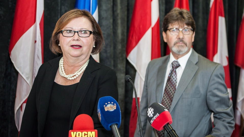 Public Works Minister Judy Foote addresses a news conference in St.John's, N.L on Thursday, Aug.24, 2017 as her husband Howard looks on. (Gerry Boland / THE CANADIAN PRESS)