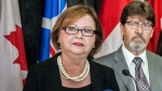 Public Works Minister Judy Foote addresses a news conference in St.John's, N.L. as her husband Howard looks on, in this photo taken on on Thursday, Aug.24, 2017. THE CANADIAN PRESS/Gerry Boland