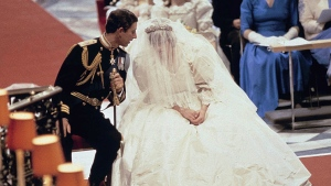 Prince Charles speaks with Princess of Wales during their wedding ceremony in St. Paul's Cathedral n London on July 29, 1981. (AP)