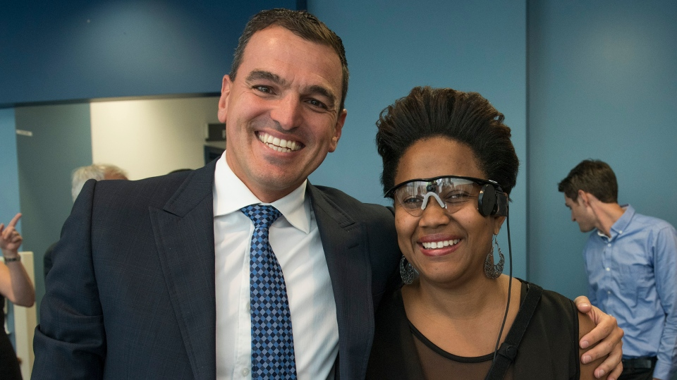 Ophthalmologist Dr. Flavio Rezende and Sandra Cassell wearing the new bionic eye device.