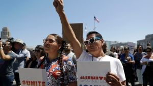 Jessica Heavy Runner, left, and her brother Eagle Tail hold signs at a rally to oppose a right-wing rally, in San Francisco, Friday, Aug. 25, 2017. (AP Photo/Marcio Jose Sanchez)