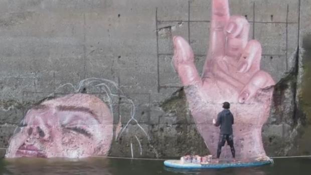 Artist blends land and sea in tide-defying Saint John mural