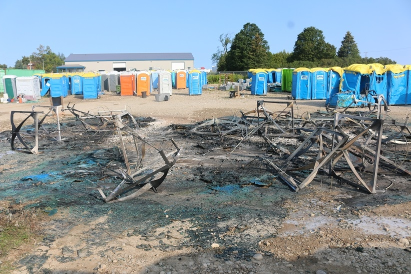 An early morning fire destroyed 24 portable toilets at a storage lot in the the town of Erin on August 26, 2017. (OPP/Marylou Schwindt)