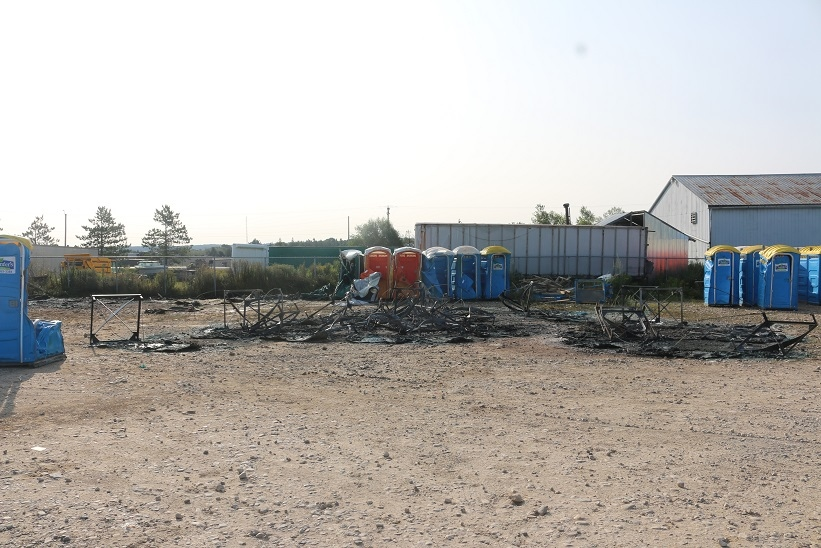 An early morning fire destroyed 24 portable toilets at a storage lot in the the town of Erin on August 25, 2017. (OPP/Marylou Schwindt)
