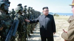 "This image made from video aired by North Korea's KRT on Saturday, Aug. 26, 2017 shows a photo of North Korean leader Kim Jong Un inspecting soldiers during what Korean Central News Agency called a ""target=striking contest"" at unknown location in North Korea. (KRT via AP Video)"