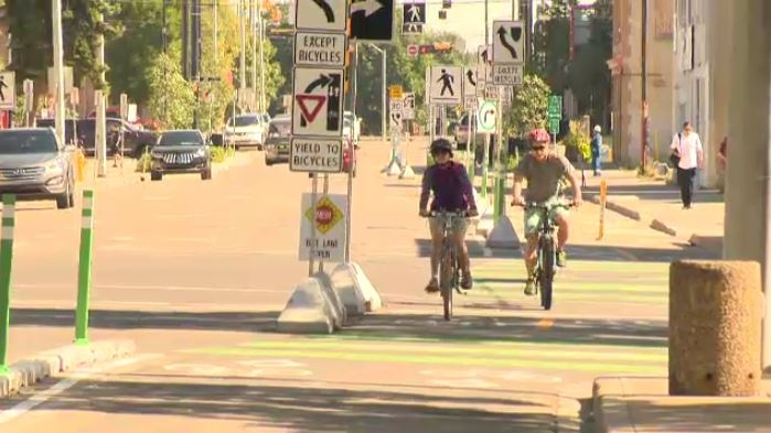 The city says the new bike lanes in downtown Edmonton are very popular, and are already looking to expand to other areas across the river.