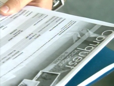 A man hoping to travel to the Bahamas through Conquest Vacations next week, shows CTV Toronto his useless e-ticket.