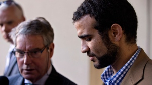 Dennis Edney, left, and Omar Khadr speak to media after a bail conditions hearing in Edmonton on Friday, September 11, 2015. THE CANADIAN PRESS/Jason Franson