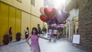 A woman poses with balloons during the Qixi Festival. (FRED DUFOUR / AFP)