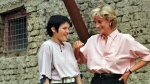 Diana, Princess of Wales, right, chats with 15-year old landmine victim Bosnian muslim girl Mirzeta Gabelic, in front of Mirzeta's home in Sarajevo, while Diana was on a visit to the region as part of her campaign against landmines, on Sunday, Aug. 10, 1997. (AP / Hidajet Delic)