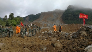 Rescuers search for survivors following a landslide in Nayong county in southwest China's Guizhou province, Monday, Aug. 28, 2017. (Chinatopix via AP)