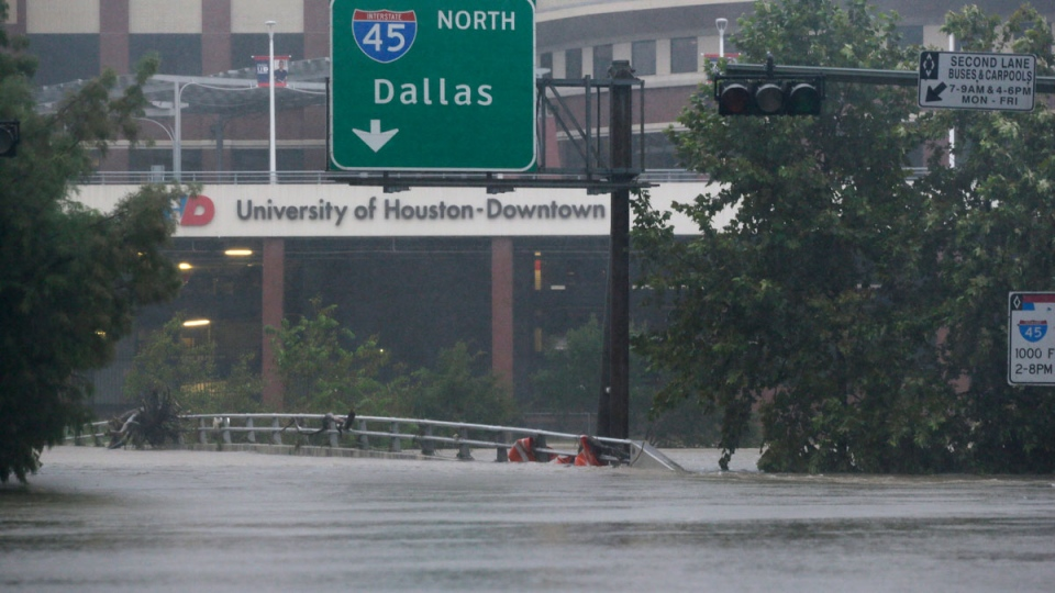 Floodwaters from Tropical Storm Harvey overflow Buffalo Bayou in Houston, Texas, Monday, Aug. 28, 2017. (LM Otero/AP)