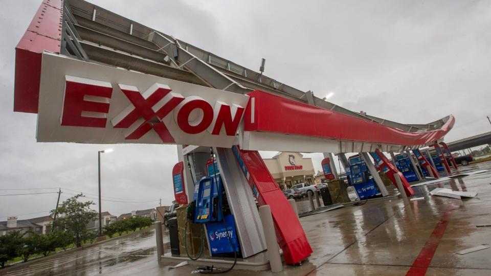 A gasoline pump awning at the Dude Stop convenience store in Webster, Texas, is partially collapsed on Sunday, Aug. 27, 2017, after remnants of Tropical Storm Harvey inundated the area. (Stuart Villanueva/The Galveston County Daily News via AP)