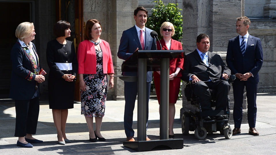 Prime Minister Justin Trudeau talks to media with members of his newly- shuffled cabinet (left to right) Carolyn Bennett, Ginette Petitpas Taylor, Jane Philpott, Carla Qualtrough, Kent Hehr and Seamus O'Regan at Rideau Hall in Ottawa on Monday, Aug. 28, 2017. (Sean Kilpatrick / THE CANADIAN PRESS)