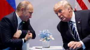 In this July 7, 2017 file photo, U.S. President Donald Trump meets with Russian President Vladimir Putin at the G20 Summit in Hamburg. (AP Photo/Evan Vucci, File)