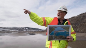 Bob Peever, of B.C. Hydro, gives a site tour of the Site C Dam location that runs along the Peace River in Fort St. John, B.C., Tuesday, April 18, 2017. (Jonathan Hayward / THE CANADIAN PRESS)