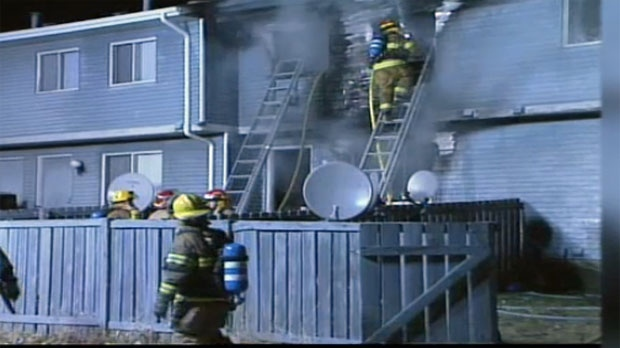 Calgary firefighters battle flames at a southeast Calgary home that was firebombed in 2004