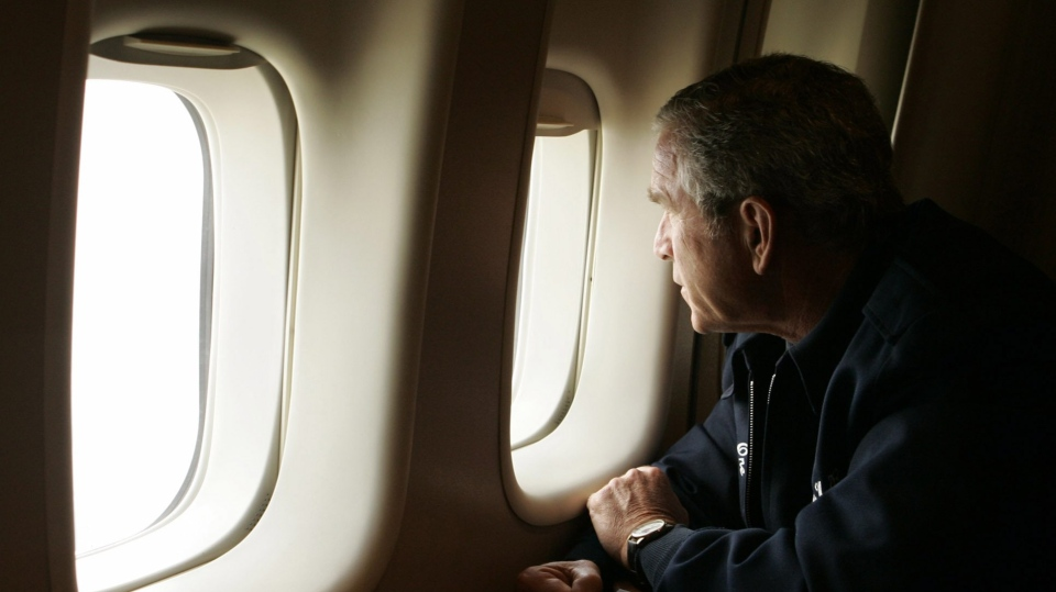 FILE - In this Aug. 31, 2005 file photo, President Bush looks out the window of Air Force One inspecting damage from Hurricane Katrina while flying over New Orleans en route back to the White House. (AP Photo/Susan Walsh, File)