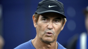 Former Baylor football coach Art Briles watches the Dallas Cowboys and the Chicago Bears warm up for an NFL football game in Arlington, Texas on Sept. 25, 2016. (AP / Ron Jenkins)