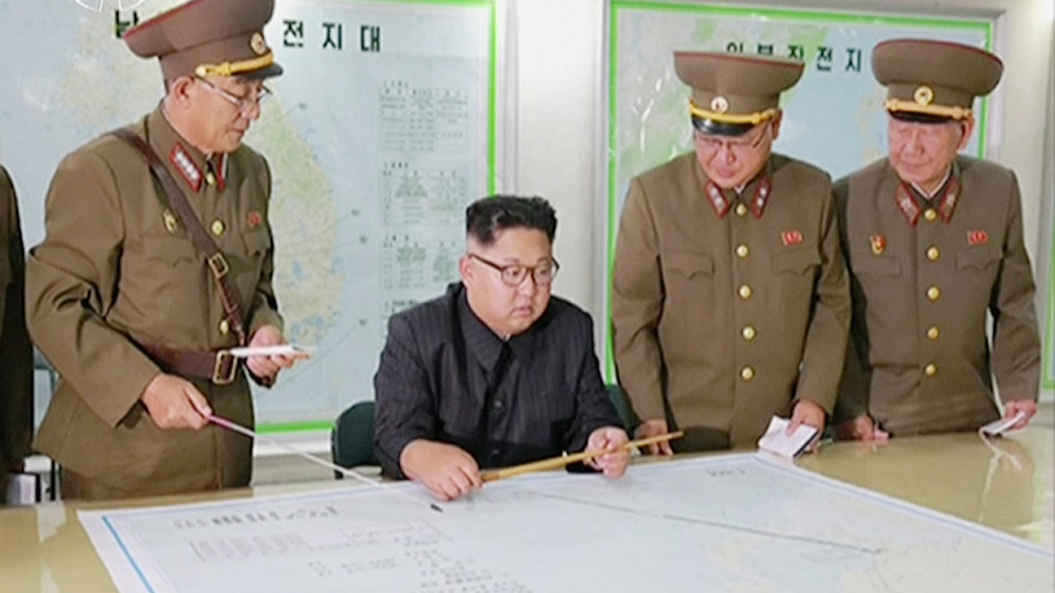 In this file image made from video of an Aug. 14, 2017, broadcast in a news bulletin by North Korea's KRT, North Korean leader Kim Jong Un receives a military briefing in Pyongyang. (KRT via AP Video)