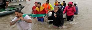 Evacuees wade down Tidwell Road