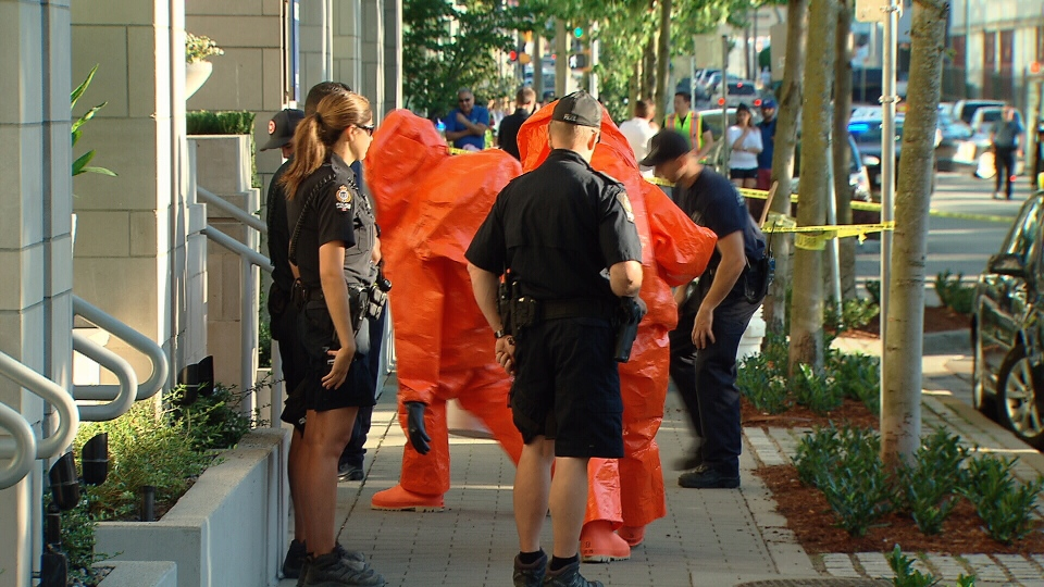 Heavily armed police broke down the door of an Olympic Village townhome before calling in the fire department's hazmat team on August 28, 2017. (CTV)