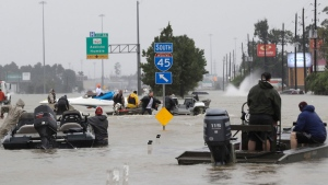 Volunteer rescue boats make their way into a flooded subdivision to rescue stranded residents as floodwaters from Tropical Storm Harvey rise Monday, Aug. 28, 2017, in Spring, Texas. (David J. Phillip/AP)