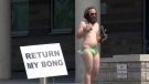 A man protests outside the Kitchener courthouse on Tuesday, Aug. 29, 2017.